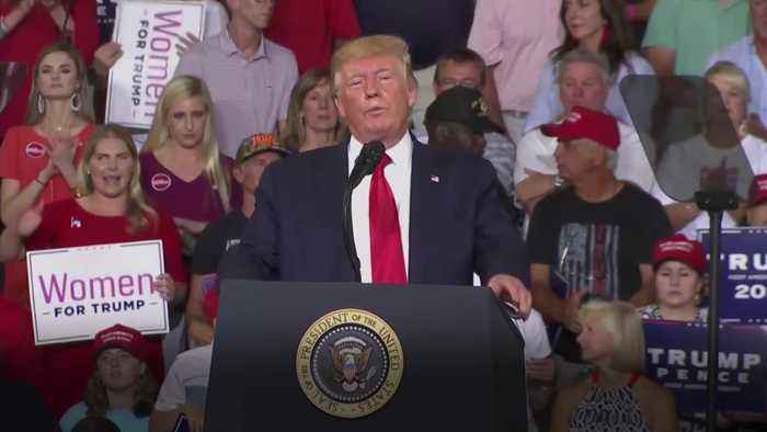 Trump hits out at congresswomen at rally as crowd roars 'send her back'