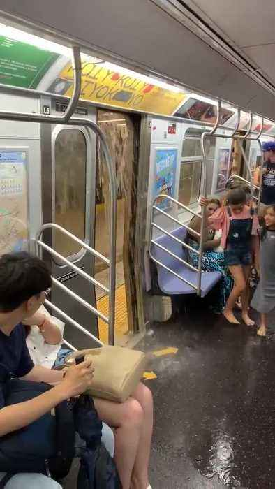 Rainwater Pours Inside Subway Train at New York City
