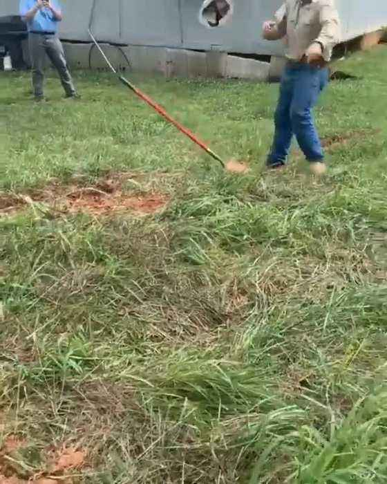 Man Hits Self in Face Attempting to Flip Helmet with Shovel