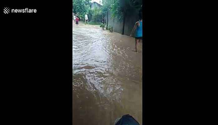 Storm Falcon leaves flooded streets behind after exiting the Philippines