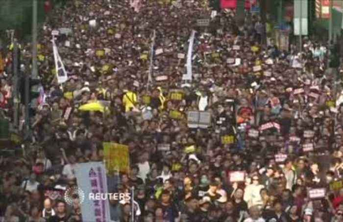 Tens of thousand march for democratic reform in Hong Kong amid political tensions