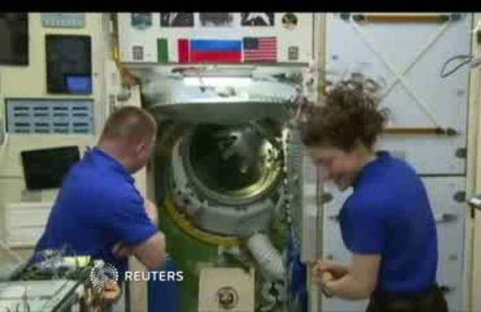 Astronauts arrive at ISS on Apollo anniversary