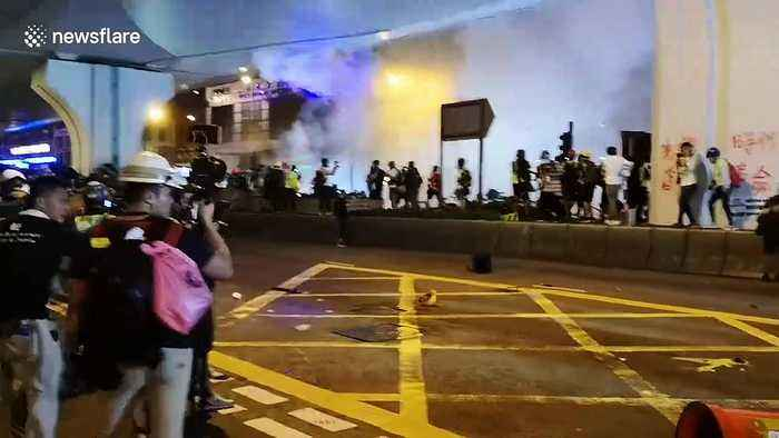 Chaotic scenes in Hong Kong as riot police fire tear gas at protesters