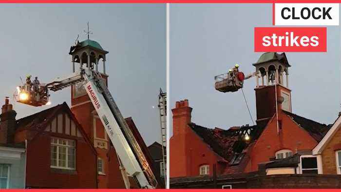 A Grade-II listed bell tower went up in flames after it was struck by lightning