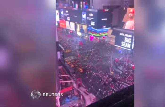 Panic in Times Square after motorcycle backfire