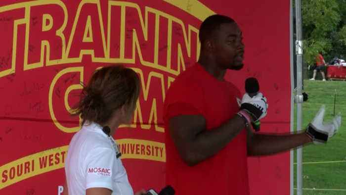 Chris Jones speaks to high school football players