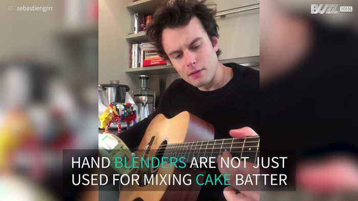 Guitarist plays 'Pulp Fiction' theme song with hand blender