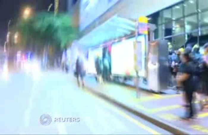 Hong Kong police fire tear gas, hit protesters in subway