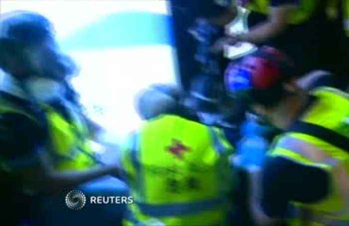 Woman hurts eye as police arrest Hong Kong protesters