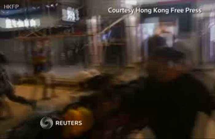 Hong Kong police pin down bloodied protester