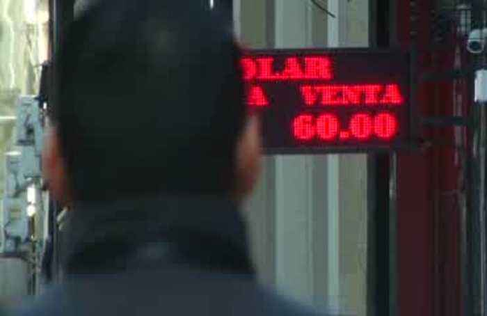 Markets jolted by Hong Kong unrest, Argentine peso crash