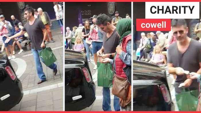 Simon Cowell gives £20 to street beggar