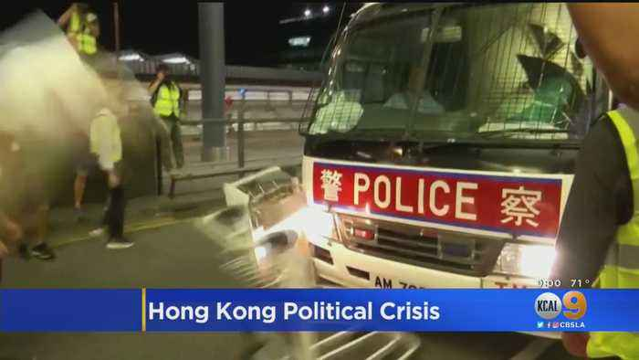 Riot Police Clash With Protesters At Hong Kong Airport As Chinese Forces Mass At Border