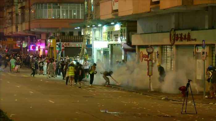 Hong Kong police fire tear gas at protesters at 'religious laser light vigil'