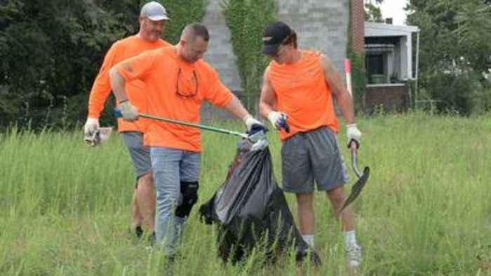 Volunteers picking up trash in West Baltimore save two men found overdosing