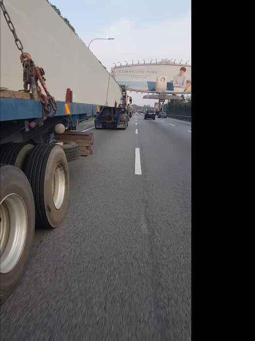 Sketchy Motorcycle Maneuver Under Semi Truck