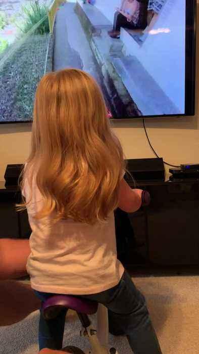 Adorable Little Girl Rides Virtual Reality Bike
