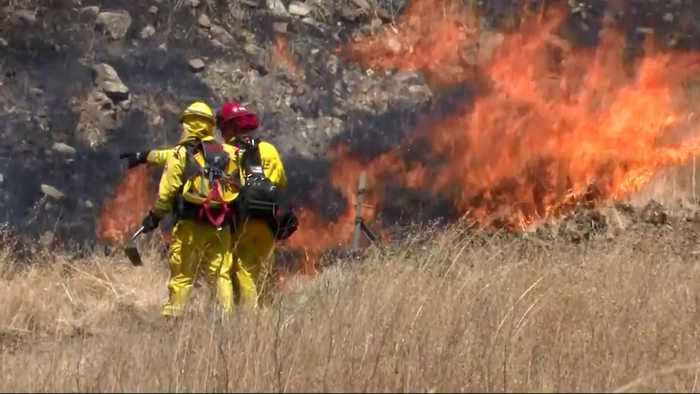 Crews Battle Heat from Flames and Weather in San Jose Brush Fire