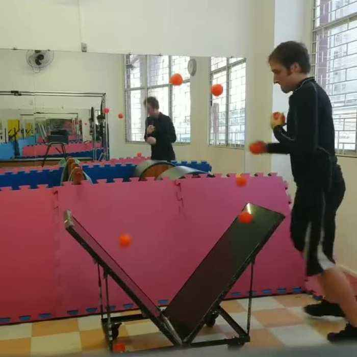 Man Juggles With Seven Balls