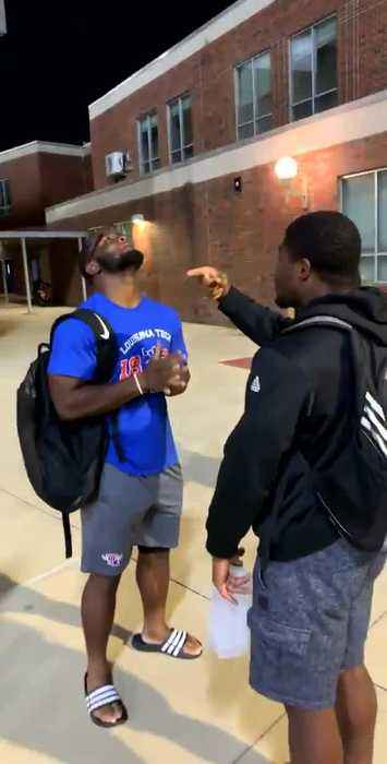 Two Guys Play Funny Game Where They Point Fingers at Each Other