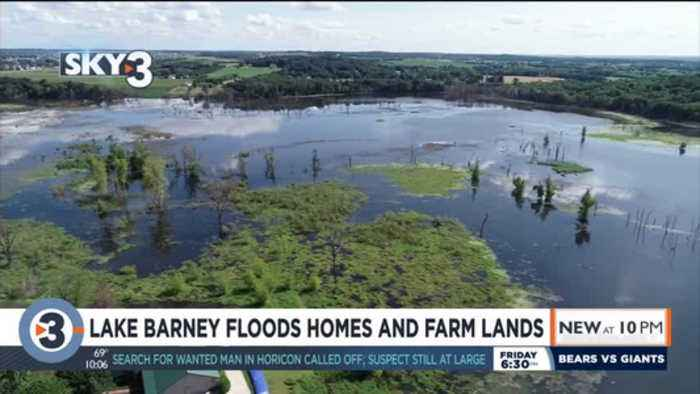 Lake Barney floods homes and farm lands