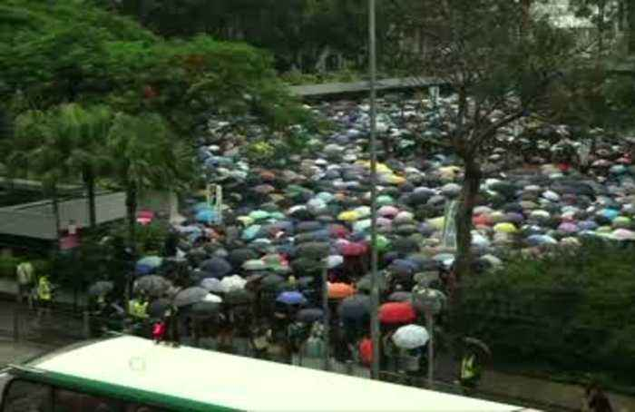 Hong Kong teachers rally in thunderstorm at start of weekend of protests