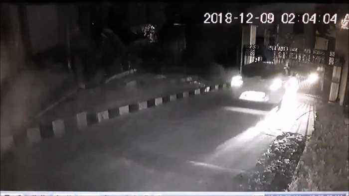 Security guard barely survives being struck by high-speed car at hotel gate