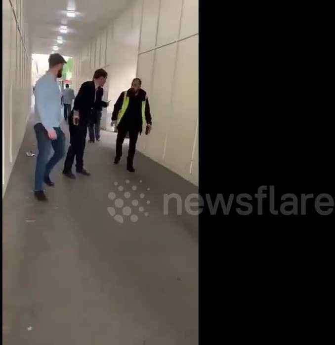 Shocking moment security guard kicks homeless man near UK Parliament