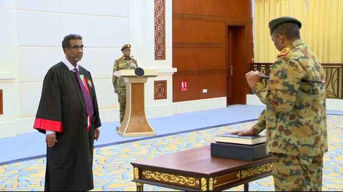 New ruling body ushers in Sudan's complex shift to civilian rule