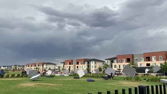 Insane footage shows mattresses getting swept away by heavy winds