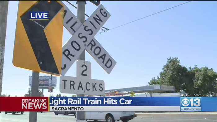 Light Rail Train Hits Car, 2 Injured