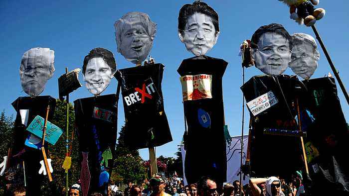 G7 protests: Thousands march against summit