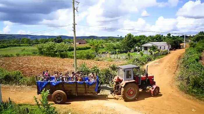 Watch: Tractor pool for Cuba's children tours tobacco zone