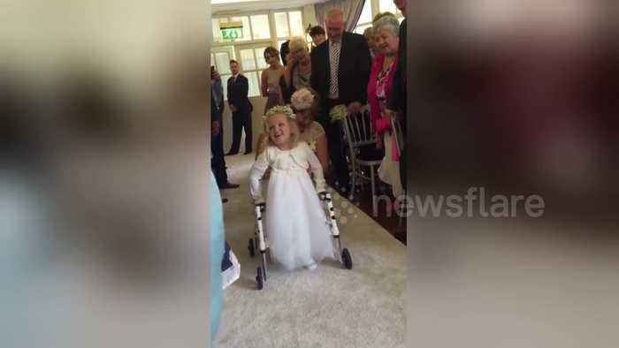 Heartwarming moment 4-year-old daughter walks for the first time at mother's wedding