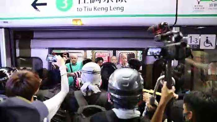 Confrontation between pro and anti-government groups on Hong Kong MRT