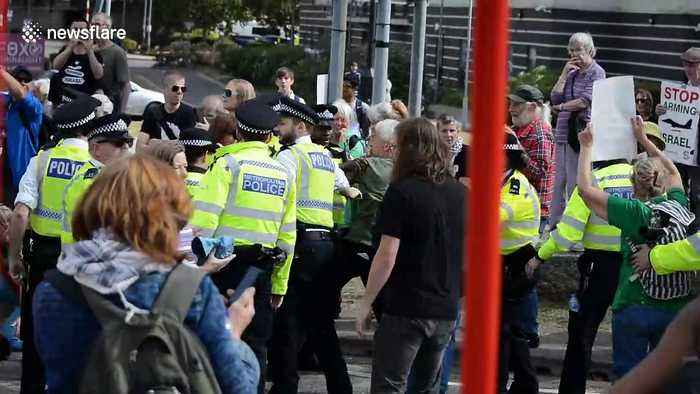 Police and protesters clash ahead of controversial arms fair in London