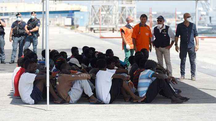 Migrants disembark from German rescue ship seized in Italy
