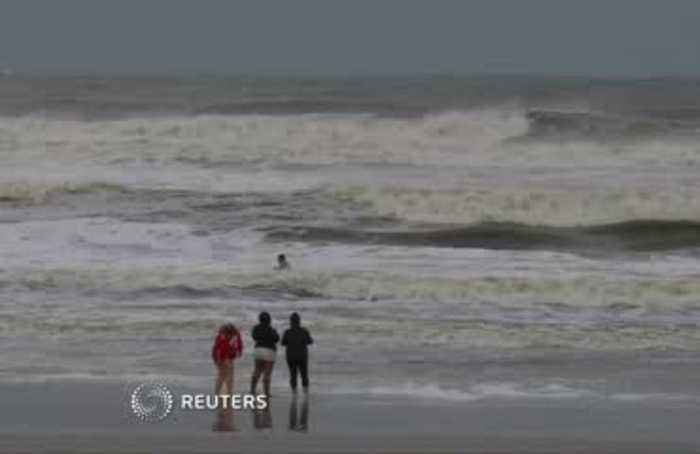 Man goes swimming as Dorian grazes Florida coast