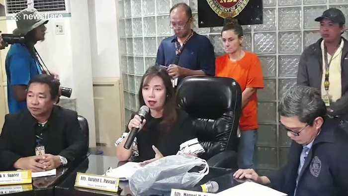US woman, 43, caught trying to smuggle newborn baby out of the Philippines 'wanted to adopt the infant'