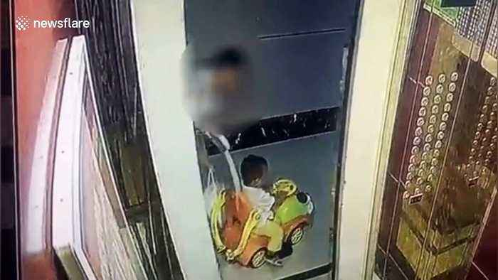 Chinese toddler thrown out of toy car after rope attached gets stuck in elevator