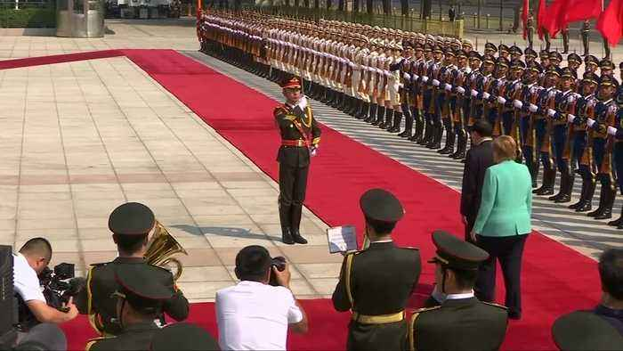 Angela Merkel welcomed in China at start of trip