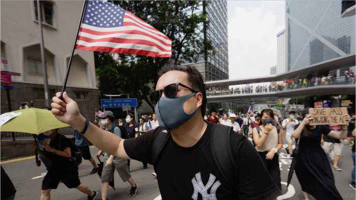 Hong Kongers March With US Flags To Plead For Trump's Help