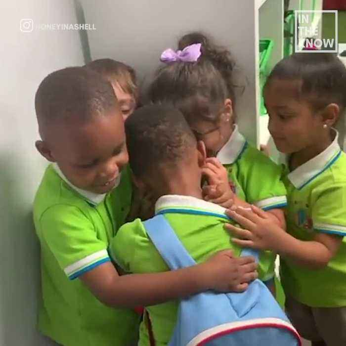 Boy is tackled with love from classmates after returning from Hurricane Dorian