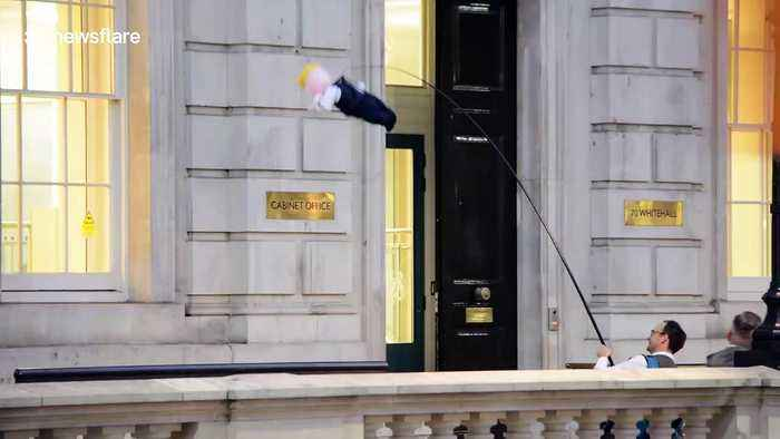 Bizarre moment Boris Johnson doll is flown in front of Cabinet Office in London
