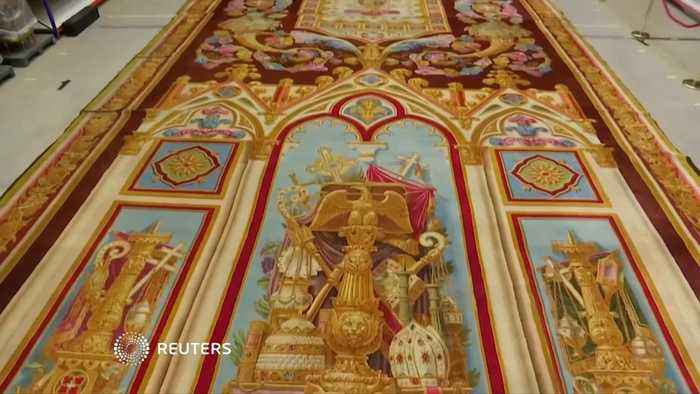 Precious carpet saved from flames at Notre-Dame goes on display