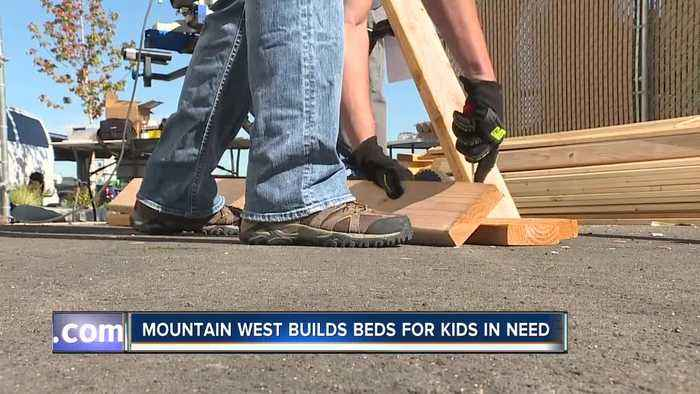 Bankers build bunk beds for kids in need