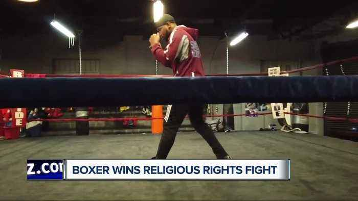 Boxer says he won round one in fight for religious rights