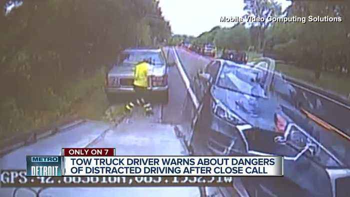 Caught on camera: Tow truck driver just misses getting hit by SUV