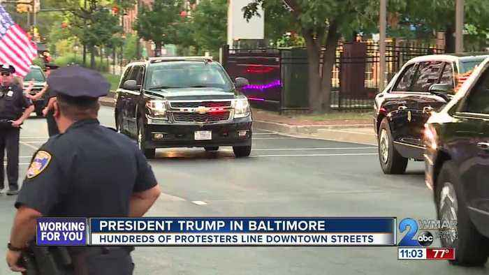 Signs, screams take over Baltimore as President Trump makes his way to the city