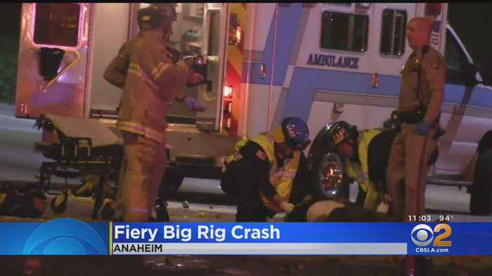Officers Take Up Fire Extinguishers To Rescue Driver From Burning Big Rig